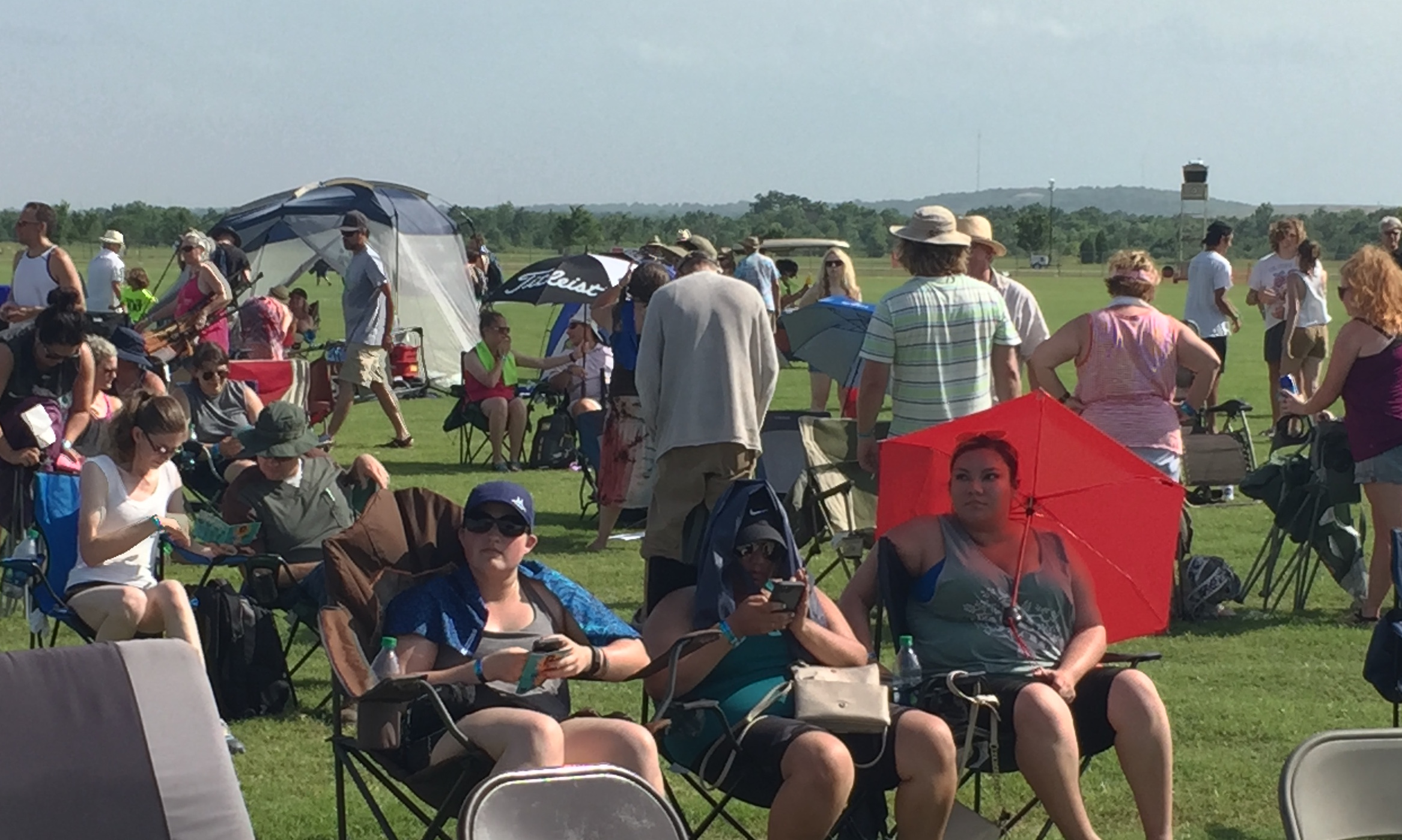 Music lovers brought chairs and umbrellas to catch all the tunes.