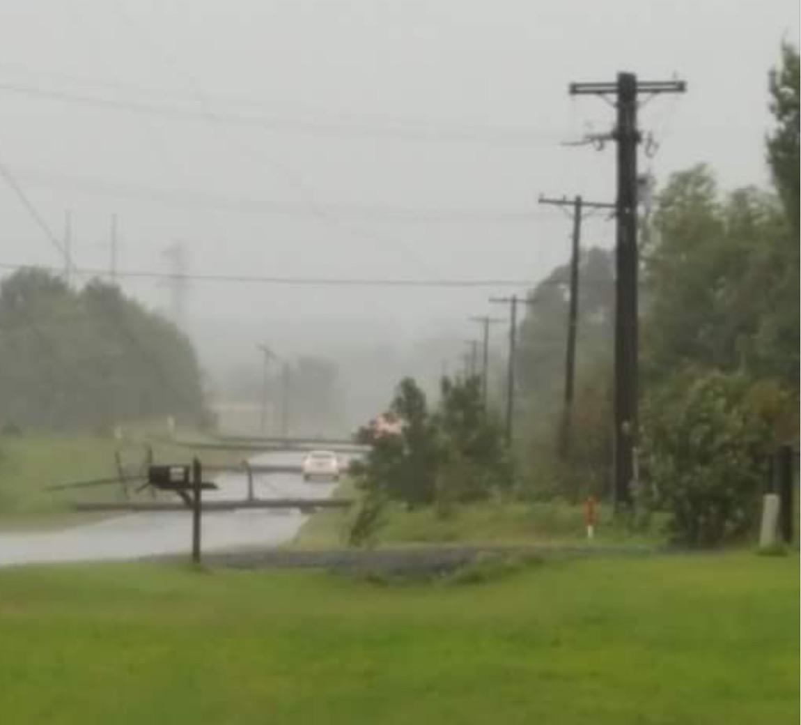 Power poles are in the road at Goosebeck Bend.