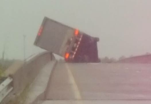 A semi is turned over on the Arkansas River bridge to Fort Gibson.