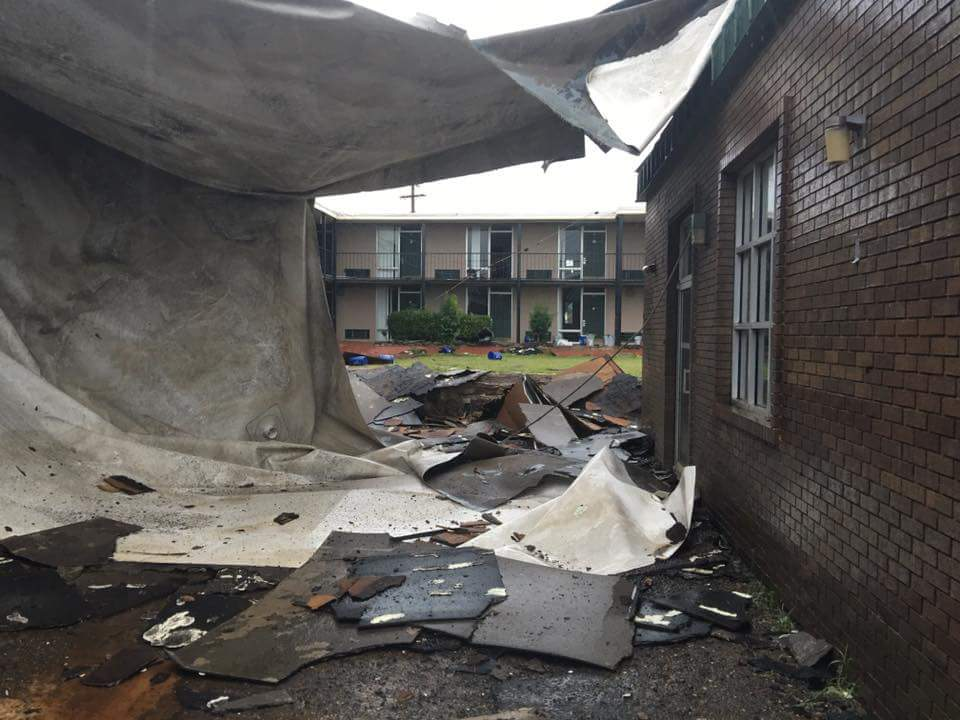 Debris covers the courtyard of the Bacone Inn.