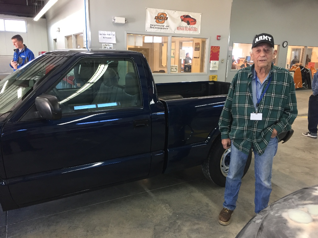 Benny Peace stands with his new truck.
