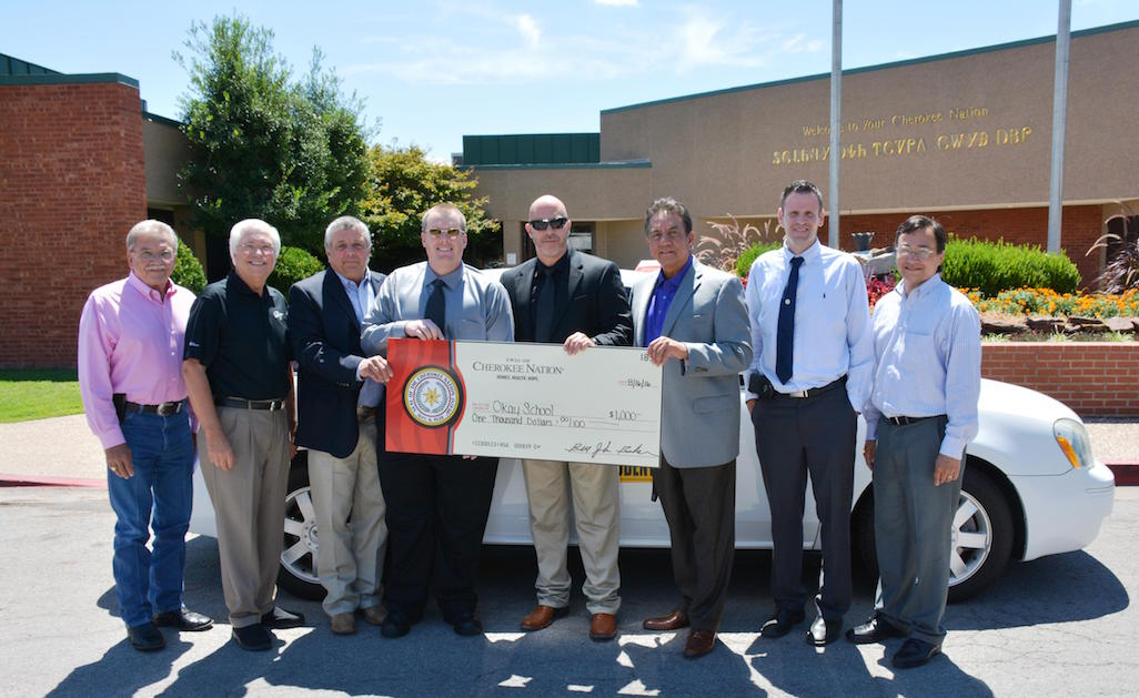 From left: Cherokee Nation Deputy Chief S. Joe Crittenden, Principal Chief Bill John Baker, Tribal Councilor Rex Jordan, Okay Public Schools Principal Mark Hayes and Superintendent Charles McMahan, Tribal Council Speaker Joe Byrd, Tribal Councilor David Walkingstick and Secretary of State Chuck Hoskin Jr.