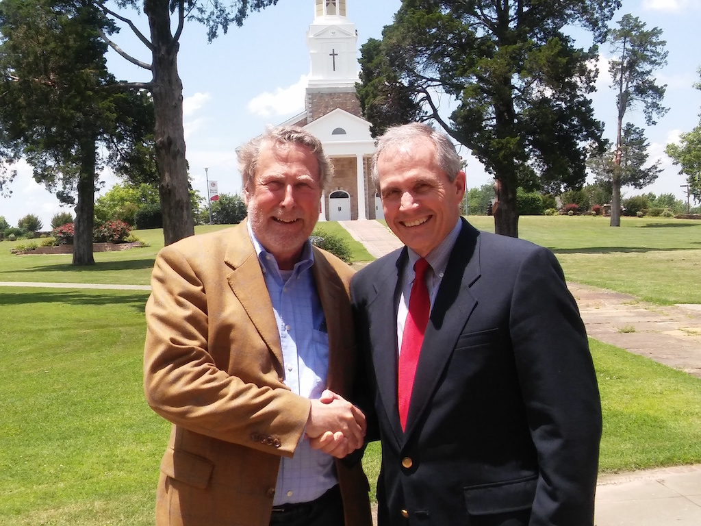 Bacone President Frank Willis and B.H. Carroll President Dr. Gene Wilkes in front of Bacone's Memorial Chapel.