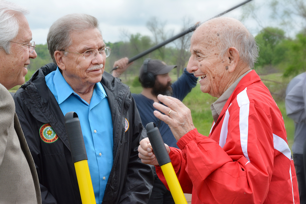 Cherokee Nation Principal Chief Bill John Baker and Deputy Chief S. Joe Crittenden visit with Cherokee Nation citizen and world champion archer Joe Thornton at the Joe Thornton Archery Range groundbreaking event.