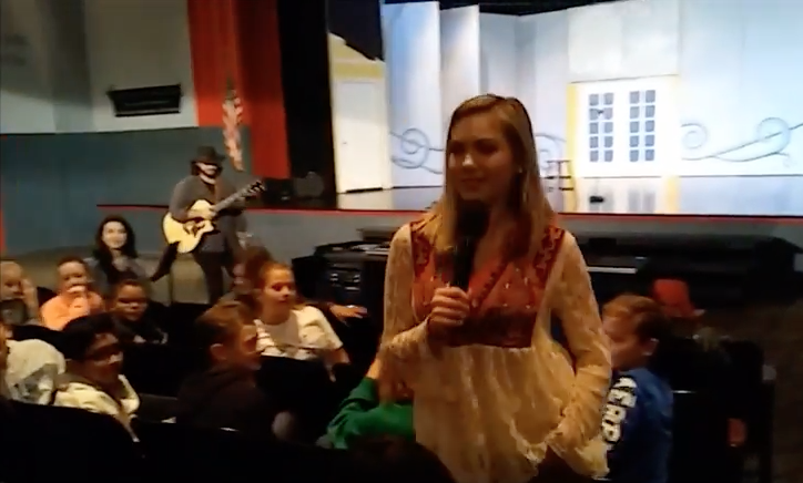 Kaitlyn Baker takes questions from students after performing last week.
