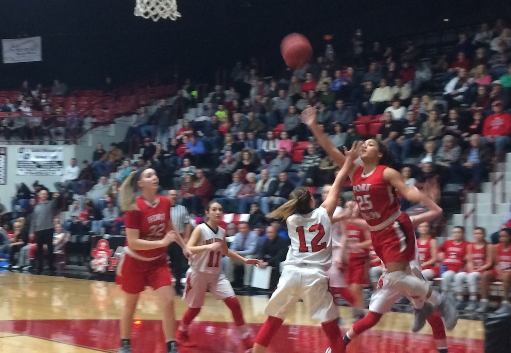 Laney Swink (25) shoots over Makenna Wilson (12) during the Fort Gibson win.
