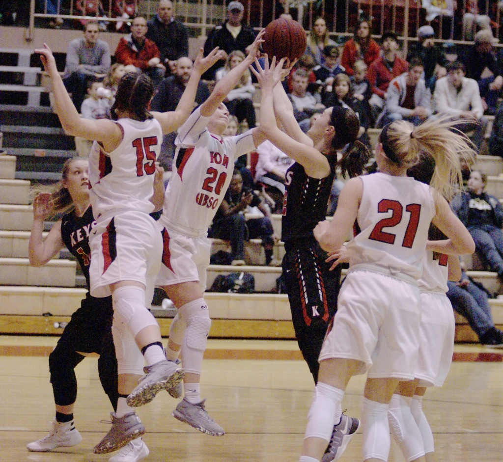 Lady Tigers' #15 Zoe Shieldnight, #20 Ali Christie and #21 Cailey Cunningham fight for the ball over Keys' #2 Haleigh Cone and #14 Pearl Angel