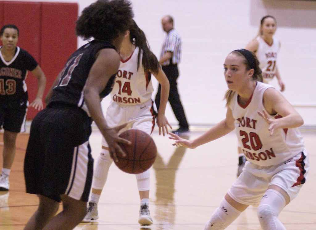 Fort Gibson's  #20 Ali Christie defends against Wagoner's #11