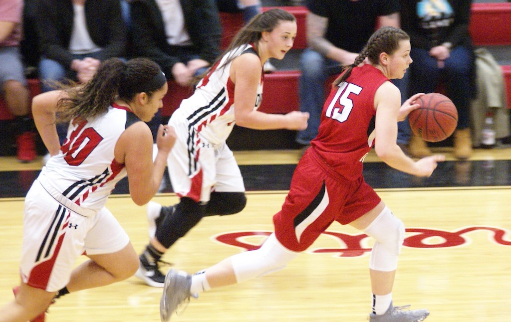 Fort Gibson's Zoe Shieldnight breaks down court as Hilldale's #30 McKayla Maxwell and #24 Taylor Sanchez chase