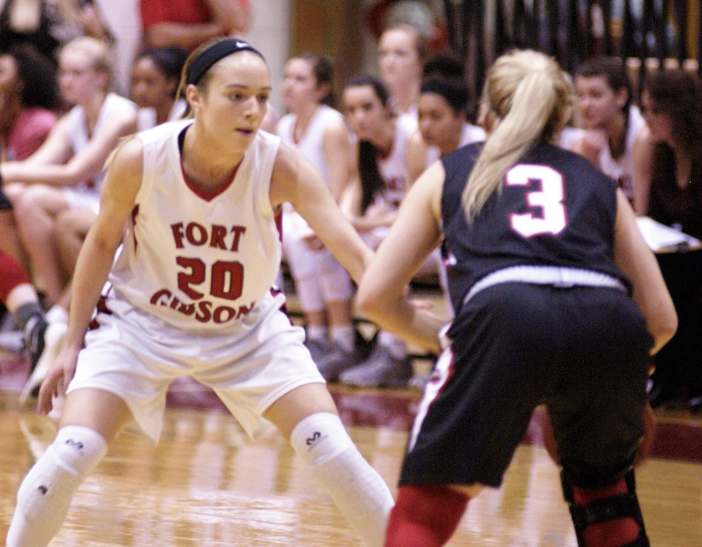 Fort Gibson's #20 Ali Christie defends against Locust Grove's #3 Katie Hildreth
