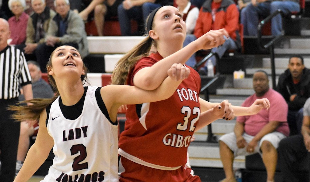 Fort Gibson's Danielle Johnson and Wagoner's Katelyn Bruce battle for position.