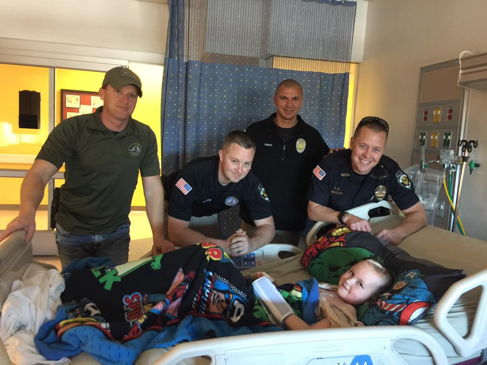 Officers Lincoln Anderson, Bob Lynch, Jake Fiero and Nick Ford visit Hunter Ward.