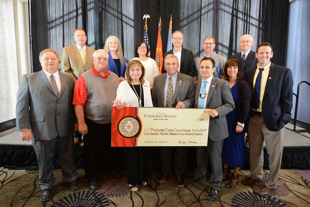 The Cherokee Nation presents a  check to Porum schools.