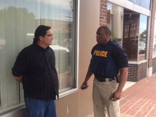 William Stephens (left), owner of Tornado King Shelters in Muskogee, was apprehended by an agent (right) with Attorney General Mike Hunter's Office yesterday.