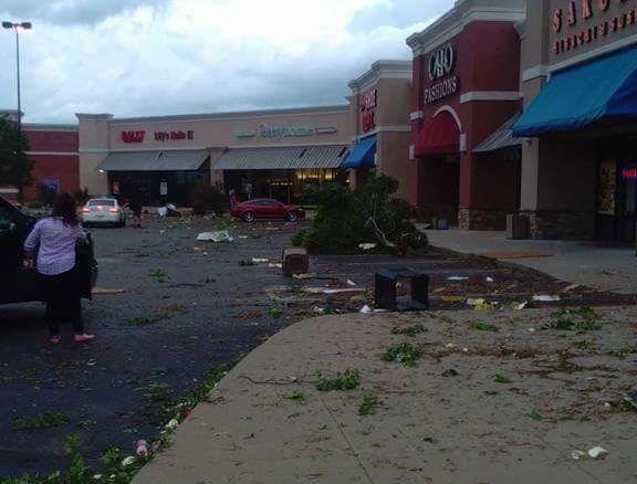 Debris fills the parking lot of the shopping center next to Walmart.