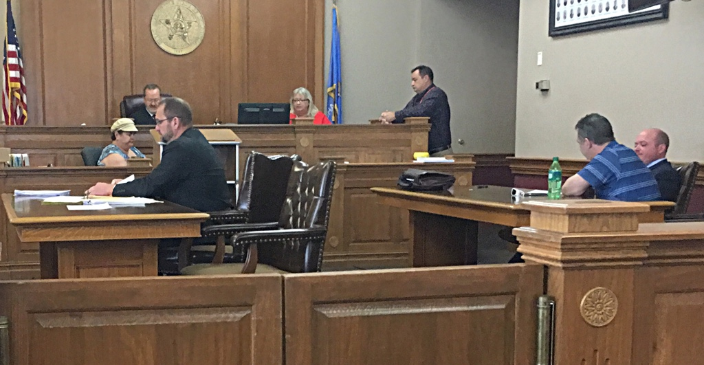 Assistant District attorney Ryan Roberts, left foreground, Judge Darrell Shepherd, background, Muskogee County Court Clerk Paula Sexton, law librarian Chris James, Thomas Dodds Jr, blue shirt and his attorney Andy Hayes review details of Dodds' blind plea of no contest.