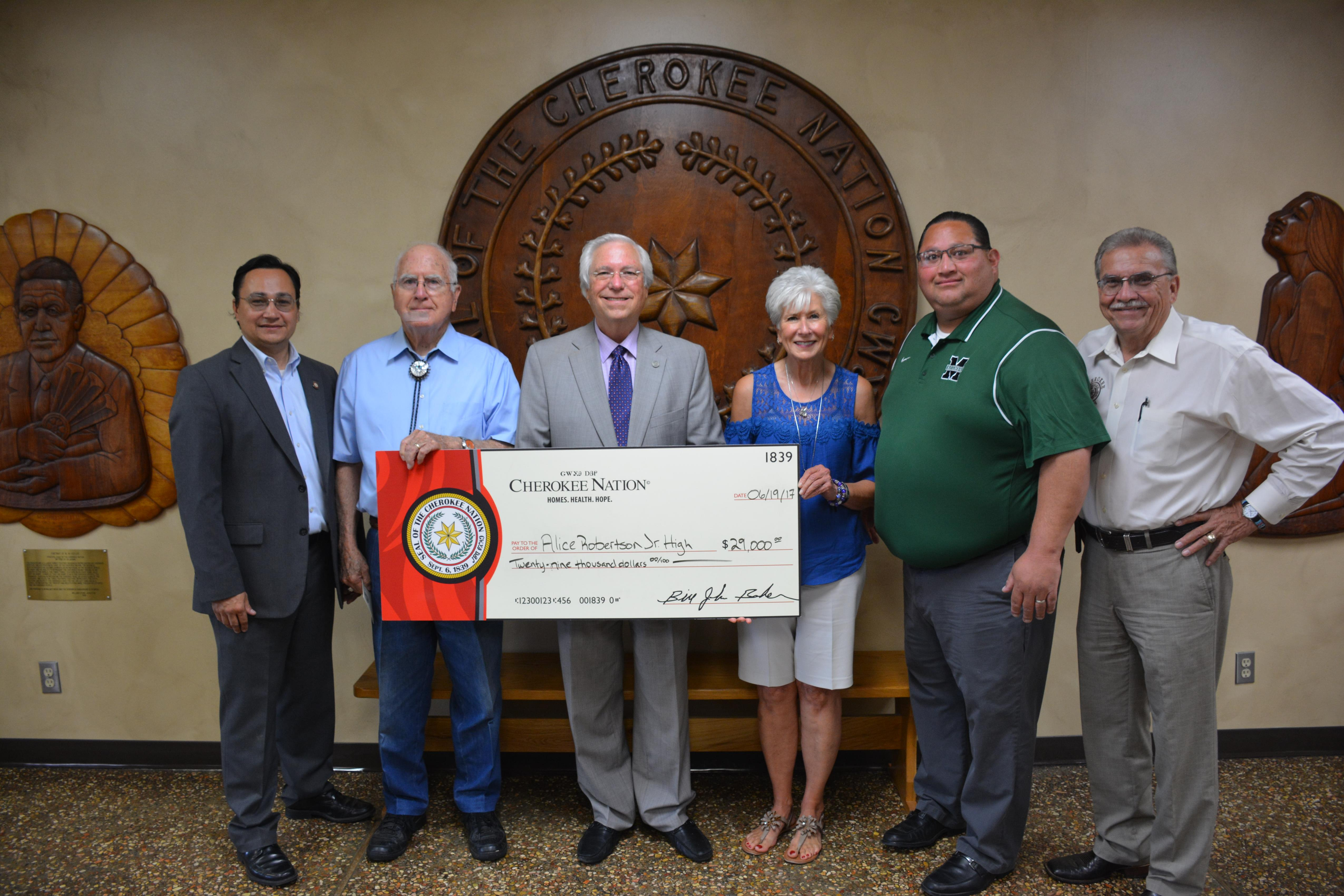 Cherokee Nation Secretary of State Chuck Hoskin Jr., Tribal Councilor Don Garvin and Principal Chief Bill John Baker, Alice Robertson Junior High School Principal Peggy Jones and Indian Education Liaison Jerrod Adair, and Deputy Chief S. Joe Crittenden.