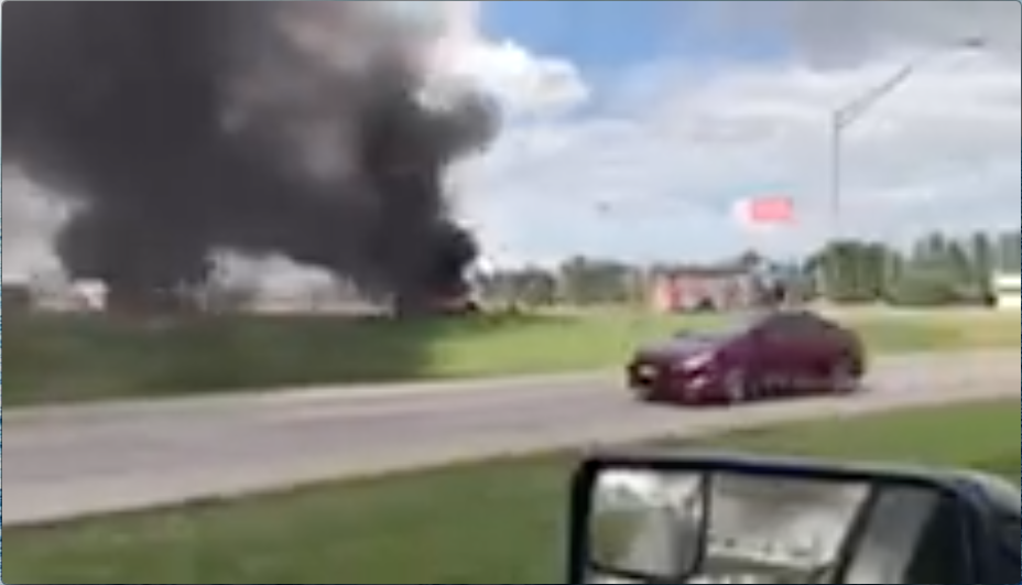 A car blazes in the Bacone parking lot at the old Walmart building.