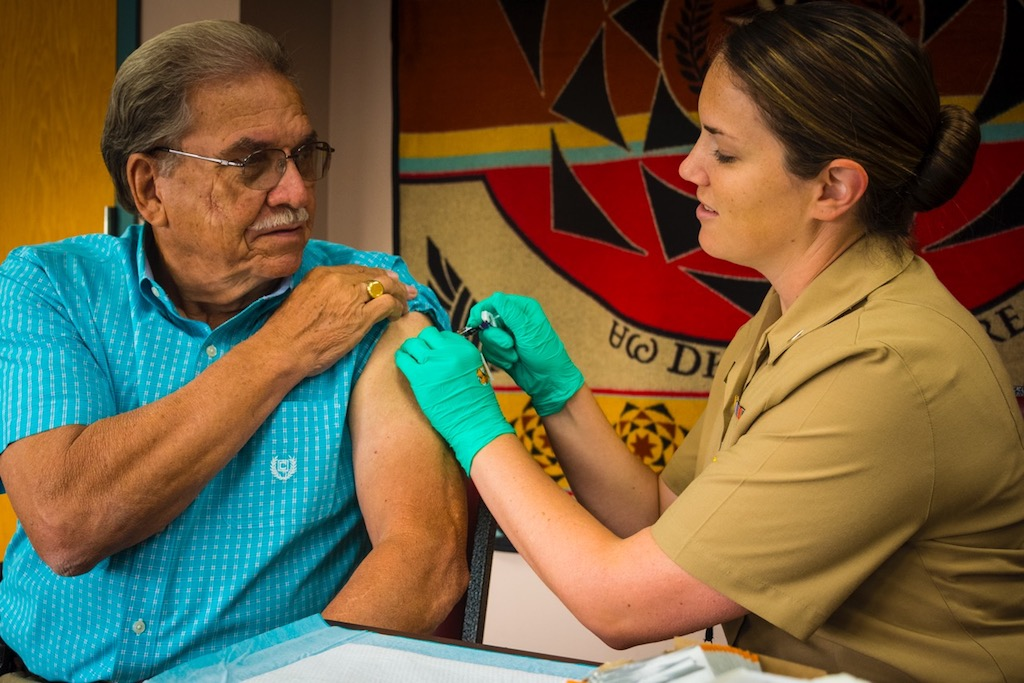 Cherokee Nation Deputy Chief S. Joe Crittenden receives his flu vaccination from Randi Duncan, occupational health nurse at W.W. Hastings Hospital.