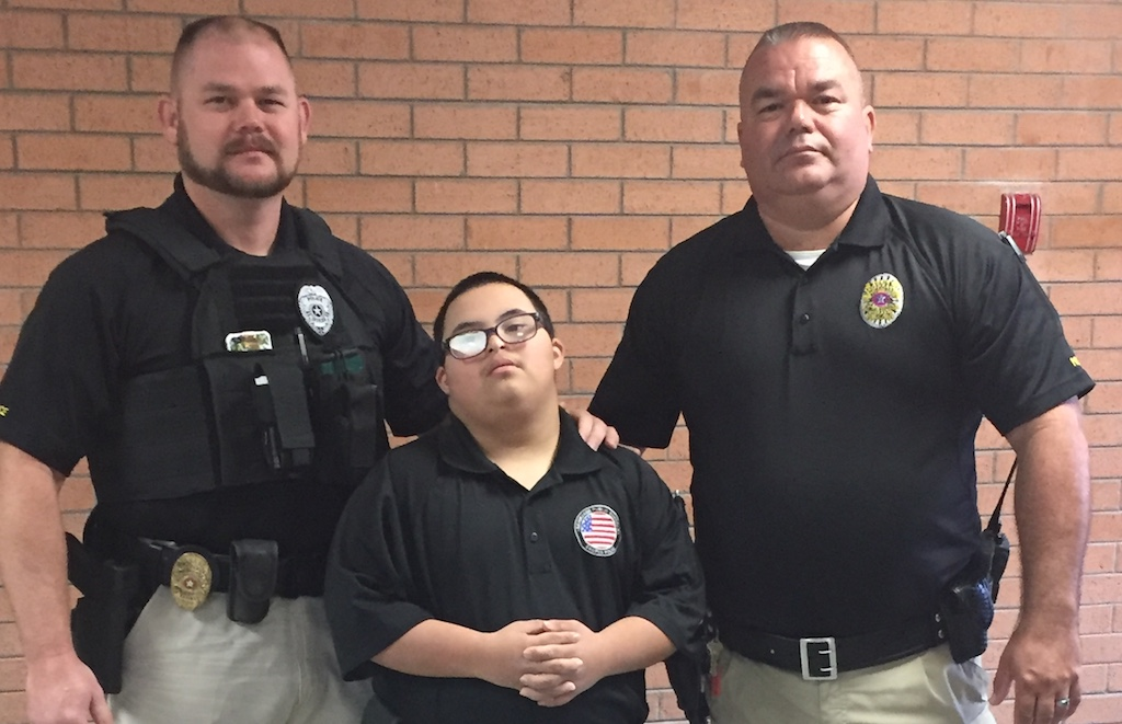 Muskogee campus police officers Brandon Combs and Doug Ragsdale pose with Anthony Sanchez.