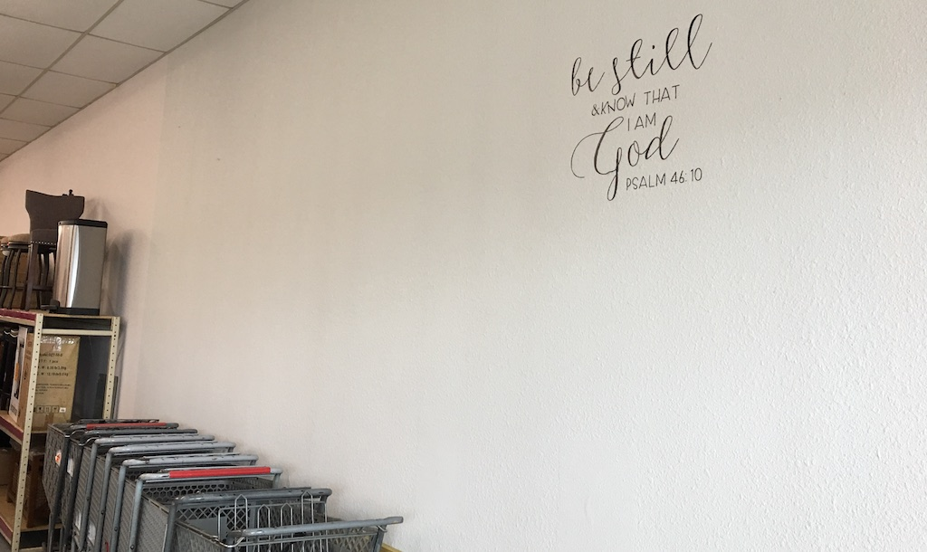 This stencil on the east wall of the new store exemplifies Johnson's philosophy.