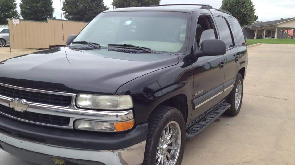 This 2003 Tahoe that was taken has cargo doors, not a hatchback.