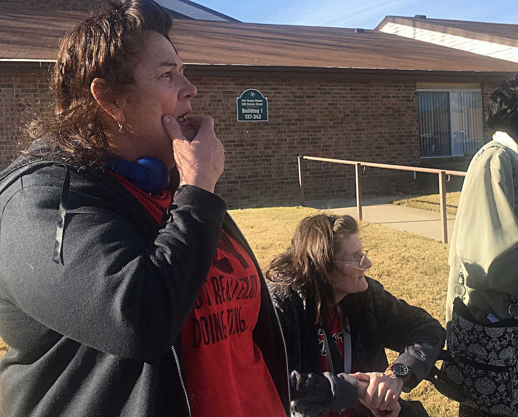 Helen Dillard and Tina Simmonsen look on helplessly as their apartments are destroyed.