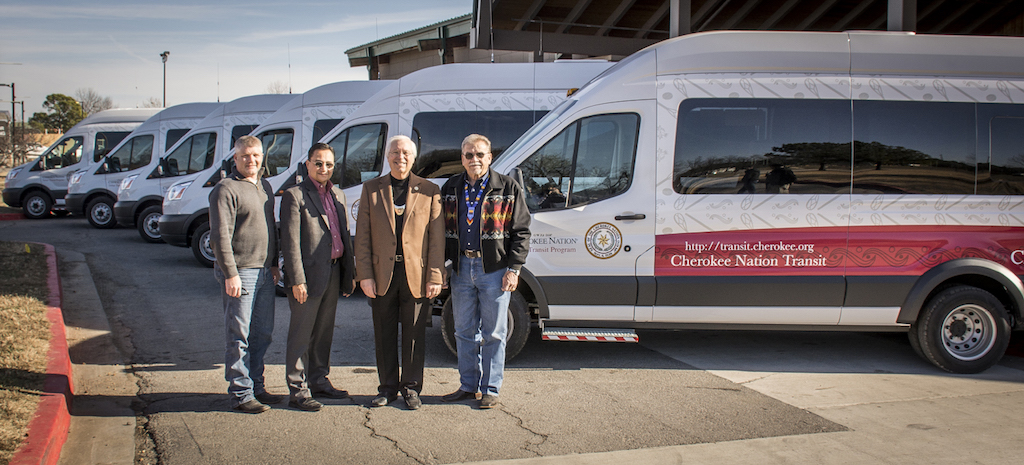 Cherokee Nation Department of Transportation Director Michael Lynn, Secretary of State Chuck Hoskin Jr., Principal Chief Bill John Baker and Deputy Chief S. Joe Crittenden get a look at six new Ford 350 Transit vans.