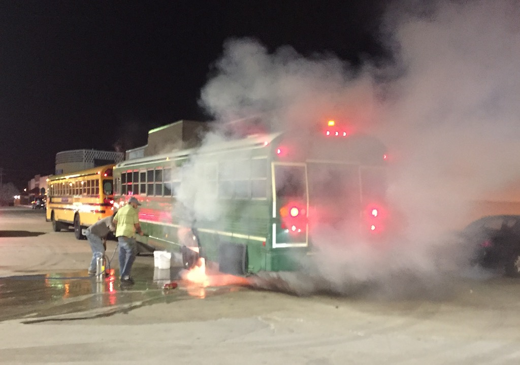 Firefighters work to extinguish a blaze in a school bus at 32nd and Okmulgee.