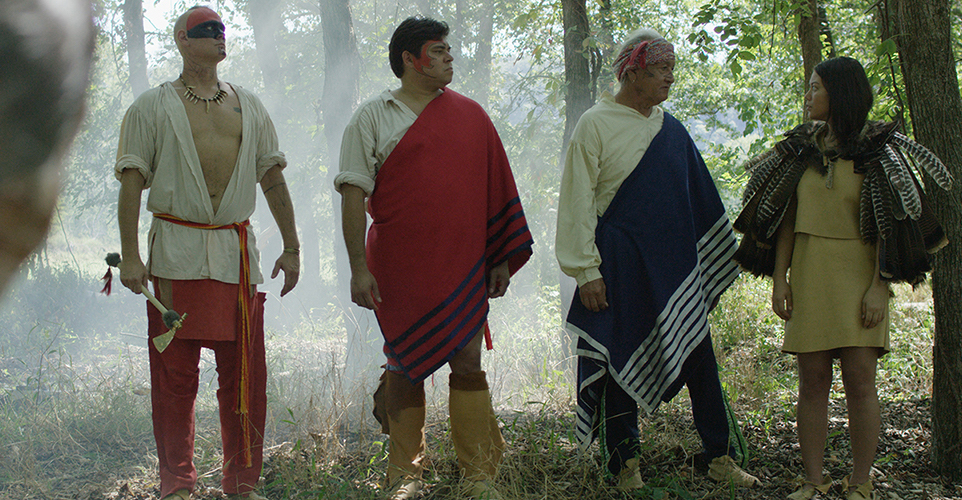 Young Nanyehi receives turkey feather cape honoring her as a tribal leader. (Left to Right) Dragging canoe, played by Travis Fite of Muskogee; Chief Oconasota, played by Michael Stopp; and Chief Attakullakulla, played by Ken Foster.