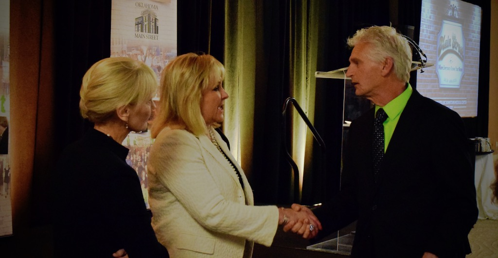 Wagoner Mayor Albert Jones, right, speaks with Gov. Mary Fallin about the benefits of signing Senate Bill 86, which would restrict the rerouting of highways.