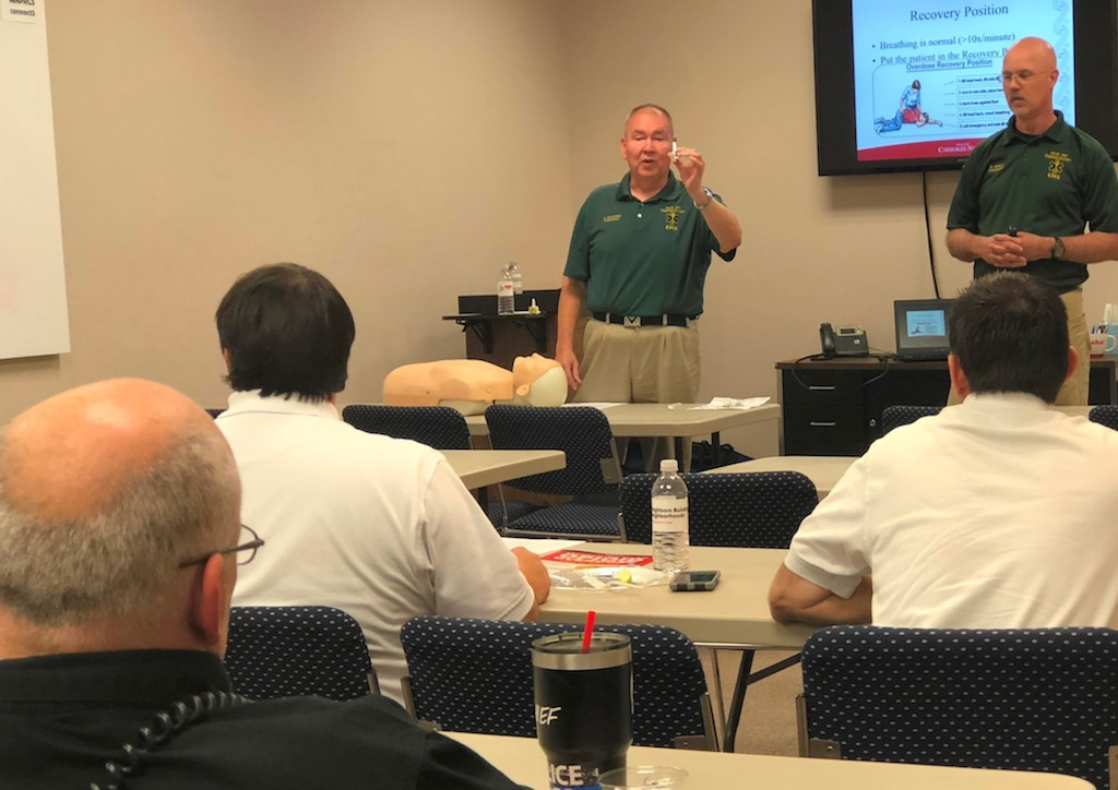 Cherokee Nation Emergency Management Services program trainer Mark Bighorse, left, shows first responders in Muskogee County how to administer Narcan during a training held on May 1.