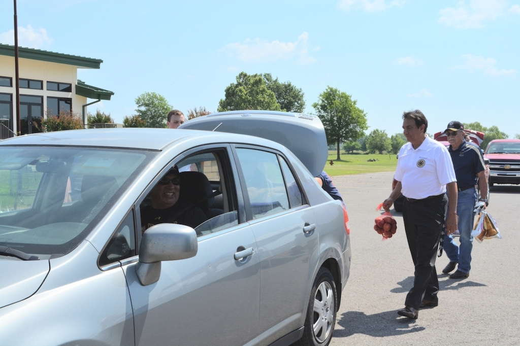 U.S. Marine Corps veteran J.C. Wilson receives food from the tribe's new mobile food pantry established with the Community Food Bank of Eastern Oklahoma. Cherokee Nation Tribal Council Speaker Joe Byrd and Deputy Chief S. Joe Crittenden helped load items in Wilson's car.