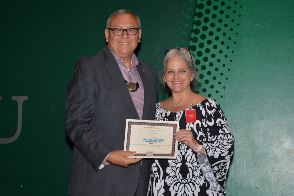 District 6 Oklahoma House Representative and Cherokee Nation Chief of Staff Chuck Hoskin presents Deanna Gordon, a second-grade teacher from Cleora Public Schools, with a $1,000 grant to fund her 'Experiencing Science' project in the fall.