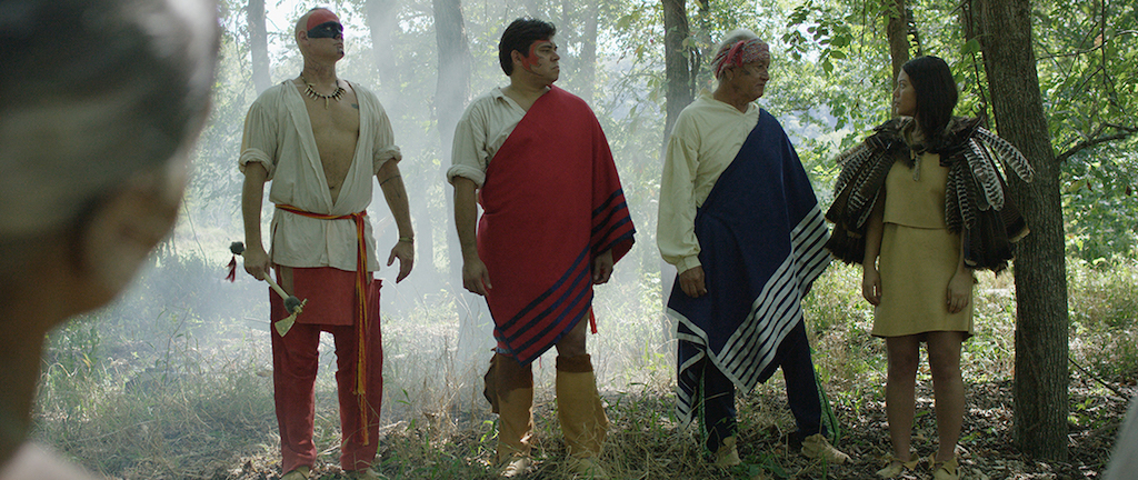 Young Nanyehi receives turkey feather cape honoring her as a tribal leader. (Left to Right) Dragging canoe, played by Travis Fite; Chief Oconasota, played by Michael Stopp; and Chief Attakullakulla, played by Ken Foster; and Young Nanyehi, played by Amber Awalt.