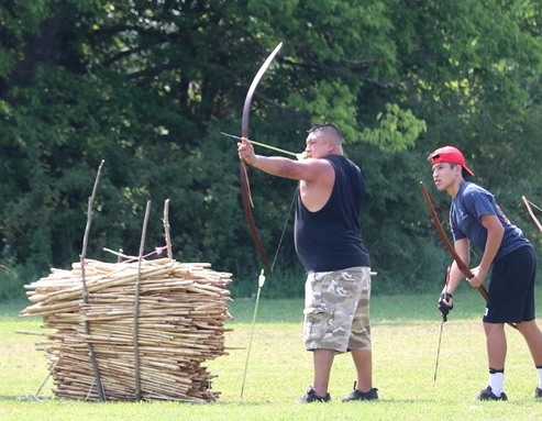 Participants compete in the cornstalk shoot competition during the Traditional Native Games Championship qualifier.