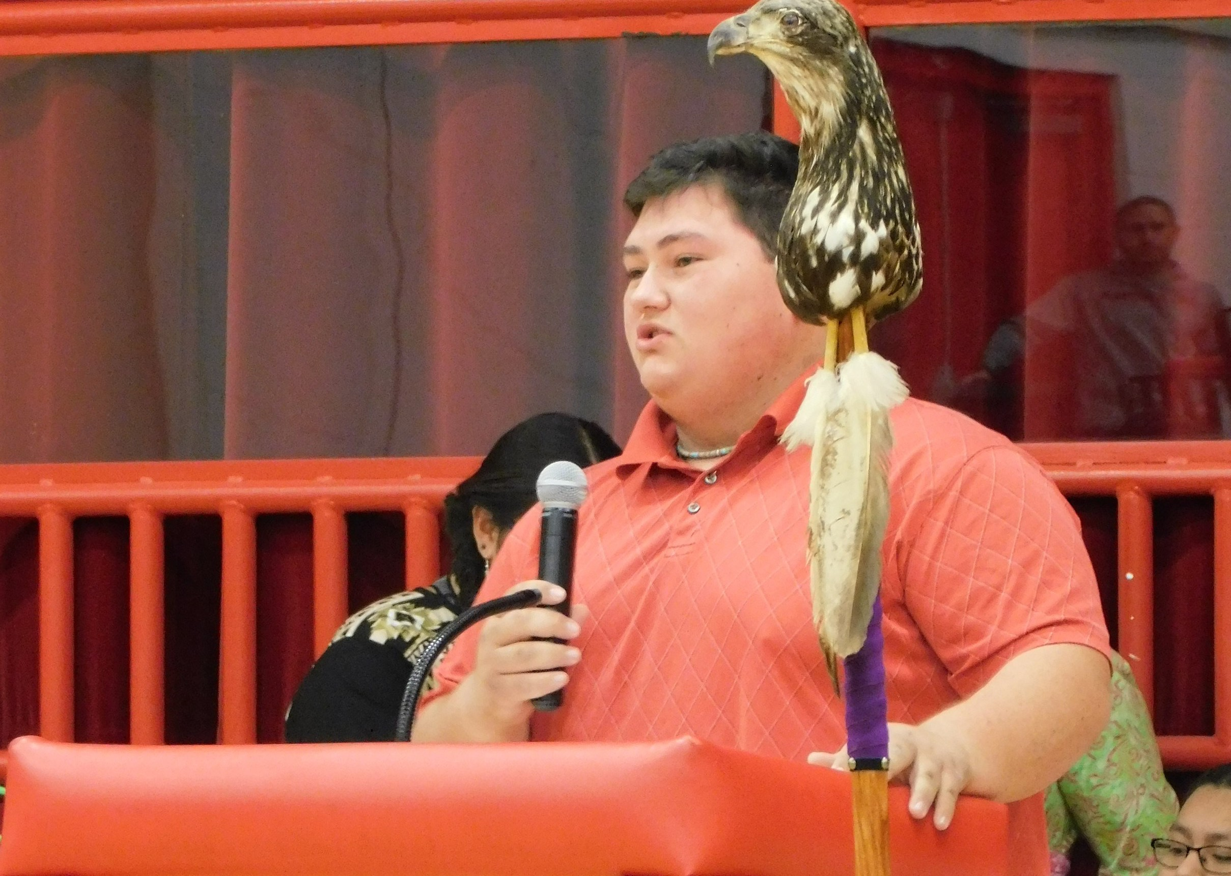 Gavin White, Hilldale senior and resident of the Native American Student Association, welcomes students to the assembly.
