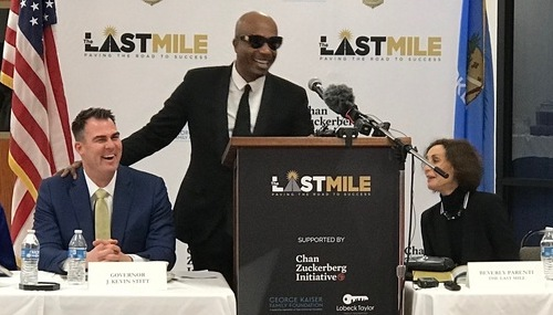 MC Hammer, right, and Gov. Kevin Stitt unveil the inmate-coding program.