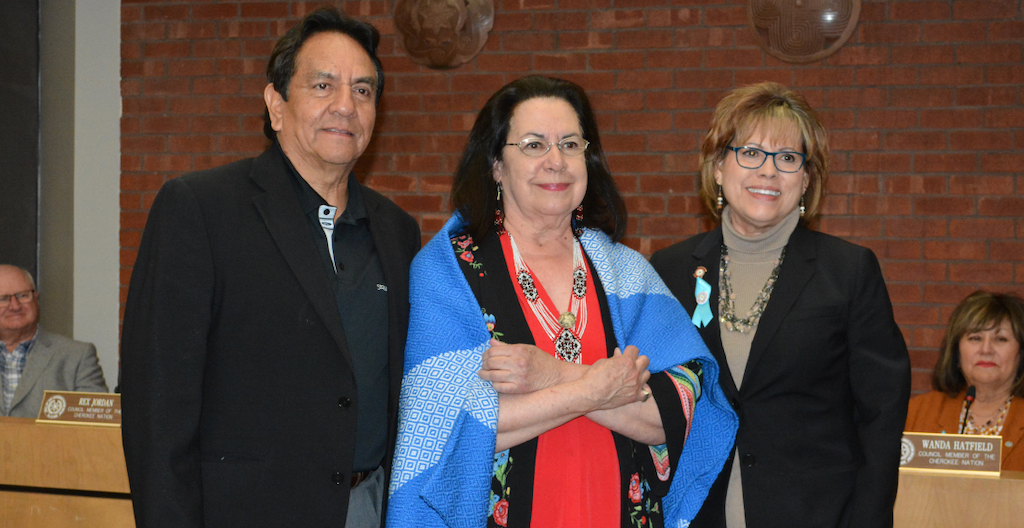 Tribal Council Speaker Joe Byrd, left, and Deputy Speaker of the Tribal Council Victoria Vazquez, right, presented Cherokee Nation citizen and acclaimed mezzo-soprano Barbara McAlister with a shawl during a special recognition at Monday night's monthly Tribal Council meeting.