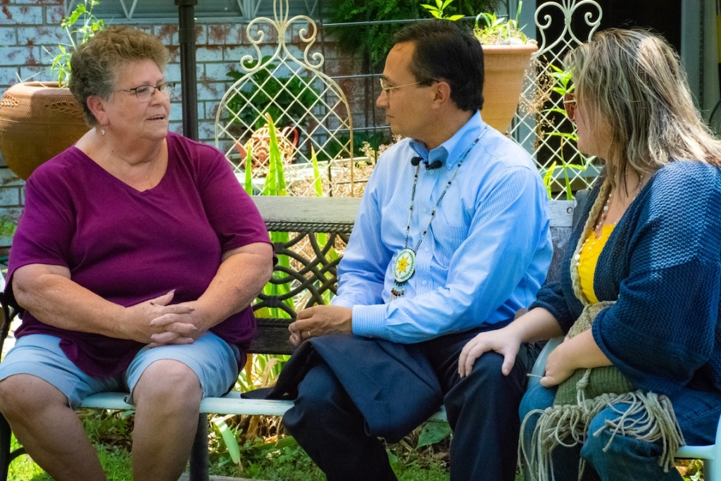 Cherokee Nation citizen Lola McKinzie visits with Cherokee Nation Principal Chief-elect Chuck Hoskin Jr. and future first lady January Hoskin at her home which received a new roof recently through the home rehabilitation program.