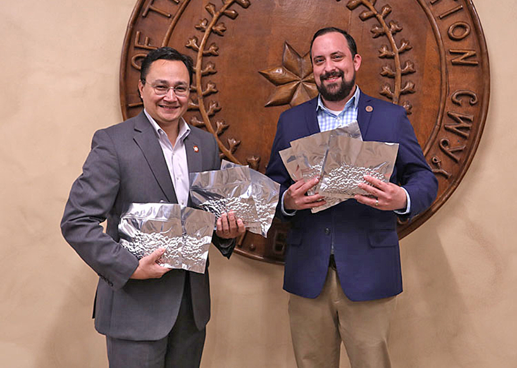 Cherokee Nation Principal Chief Chuck Hoskin Jr. and Secretary of Natural Resources Chad Harsha with heirloom seeds being sent to the Svalbard Global Seed Vault in Norway.