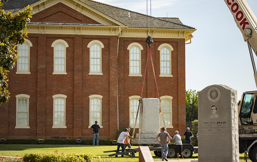 Two Confederate monuments were lifted by crane and removed from the Cherokee Nation Capitol Square in Tahlequah Saturday.