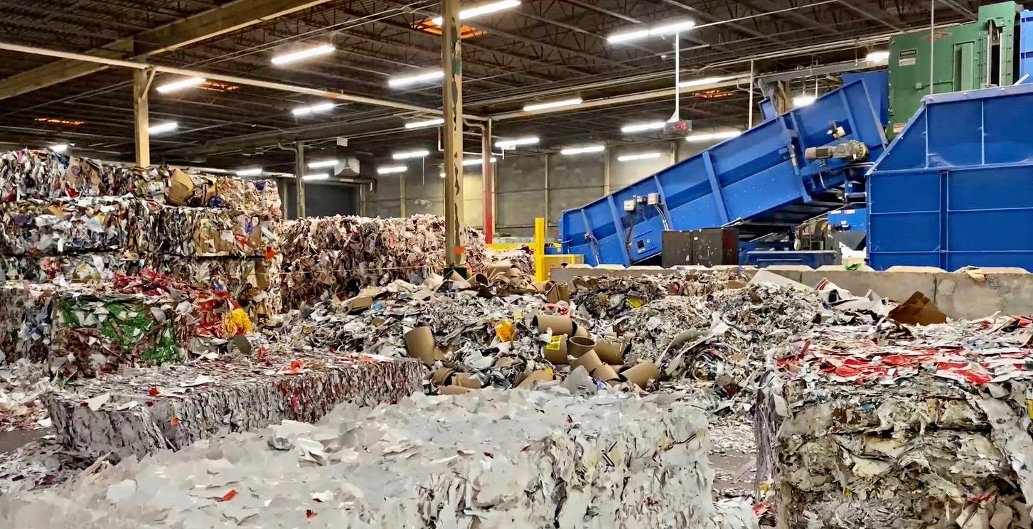 Mixed paper bales containing newspaper, junk mail and paper waste are prepared for processing at the Georgia-Pacific Muskogee mill.