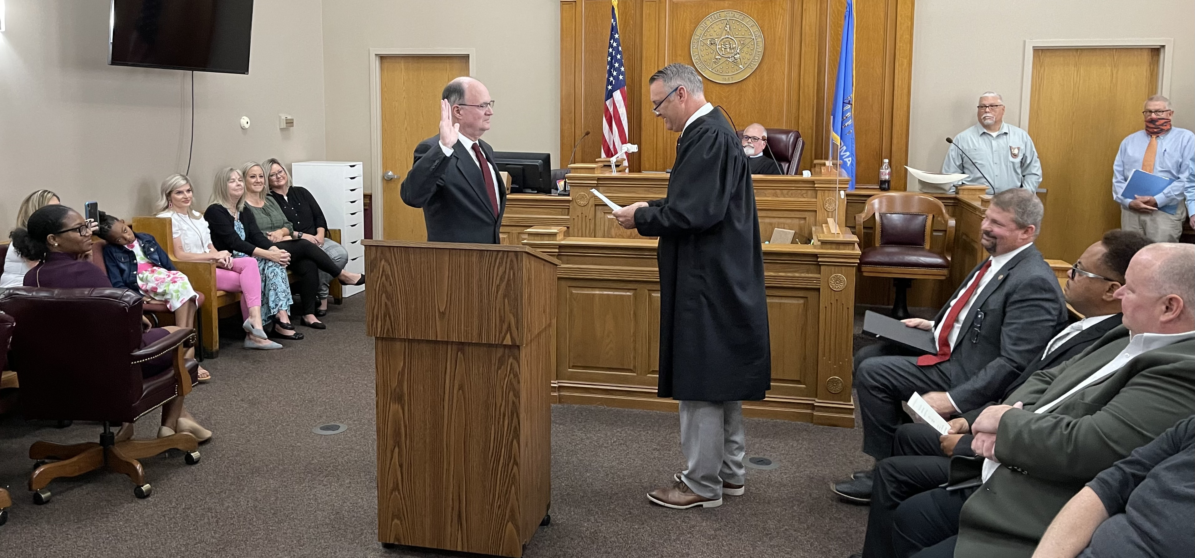 Former District Attorney and now Special District Judge Orvil Loge swears in his replacement, Larry Edwards as District Judge Bret Smith presides.