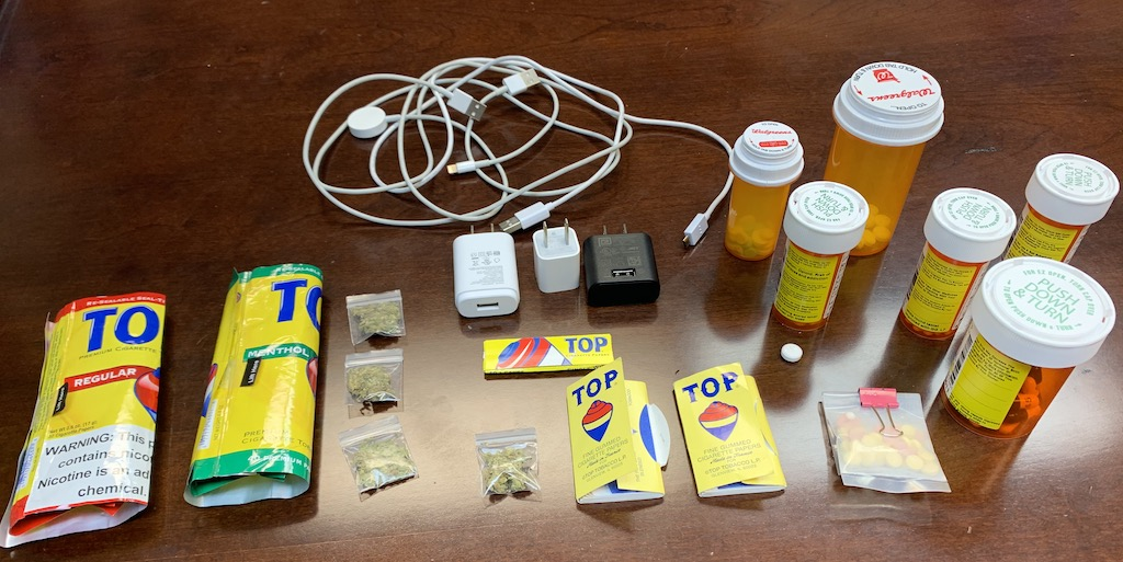 Contraband items were found on the suspect and in his car.